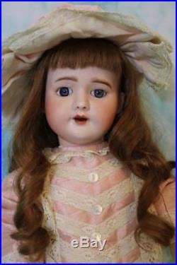 20-inch antique SFBJ 60 Paris French bisque doll French body Blue eyes Long wig