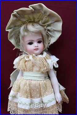 7 Antique all bisque closed mouth French doll, Original silk Clothes. Unmarked