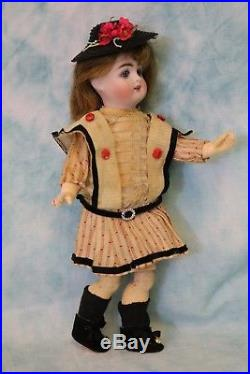9-inch Antique Kestner bisque doll marked 121 Orig compo body and factory dress