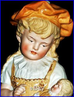 Antique German Heubach Little Girl With Her Doll Piano Baby Bisque Figurine