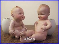 Antique Pair Of Heubach Bisque Porcelain Cracked Egg Piano Baby Doll Figures