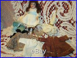 Adorable Antique doll trunk with bisque doll and extras, most accessories are