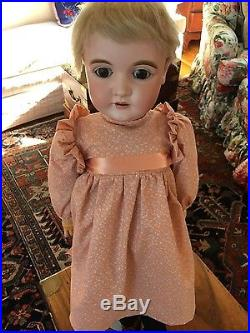 Antique 29 doll with bisque head and jointed legs and arms
