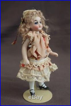 Antique 5 Mignonette doll All bisque doll for the French market