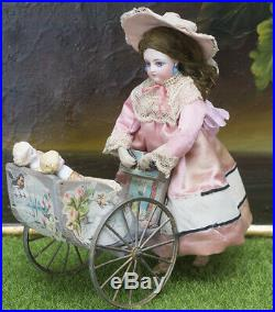 Antique French Mechanical Toy Walking doll withCarriage and 2 mignonette by Vichy