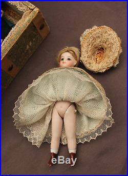 Antique French all bisque Mignonette doll in presentation trunk Ca 1880