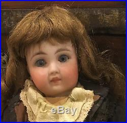 Antique French bisque Belton 13 doll closed mouth paperweight eyes pierced ears