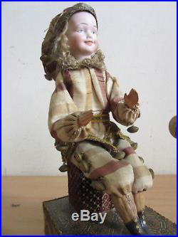 Antique French mechanical Automation Jester and Bird bisque head doll