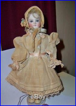 Antique French or German bisque doll string moving head and arms orig clothing