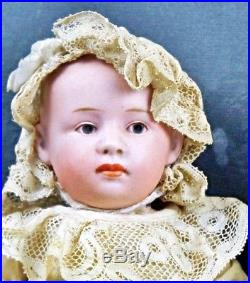 Antique German Bisque Heubach Pouty Baby Doll with Blue Intaglio Eyes 9 inch