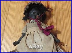 Antique German black bisque character toddler doll, glass eyes & caracul wig