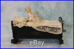 Antique Key Wind Automaton Mechanical Bisque Girl Doll in Old Cradle c. 1890