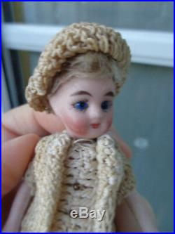 Antique dollhouse doll dated about 1900 mignonette with closed mouth & old dress