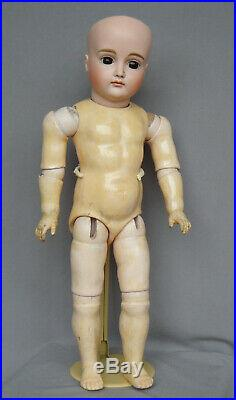 Antique early Kestner pouty doll with 8 ball jointed straight wrist body