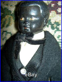Handsome antique BLACK bisque well dressed ethnic male doll Nubian Blackamoore