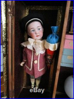 Two exquisite antique bisque Heubach dolls presented in a classroom